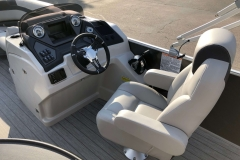 Helm and High Back Captain's Chair of the 2021 Sylvan L1 Cruise Pontoon Boat