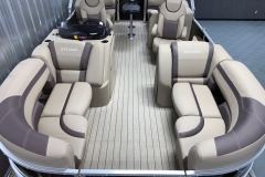 Teak Weave Vinyl Flooring of a 2022 Sylvan L1 LZ Tritoon Boat