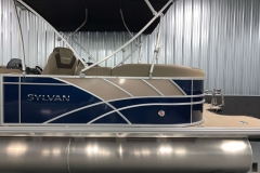 Tan Exterior Accents of the 2021 Sylvan L3 LZ Tritoon Boat