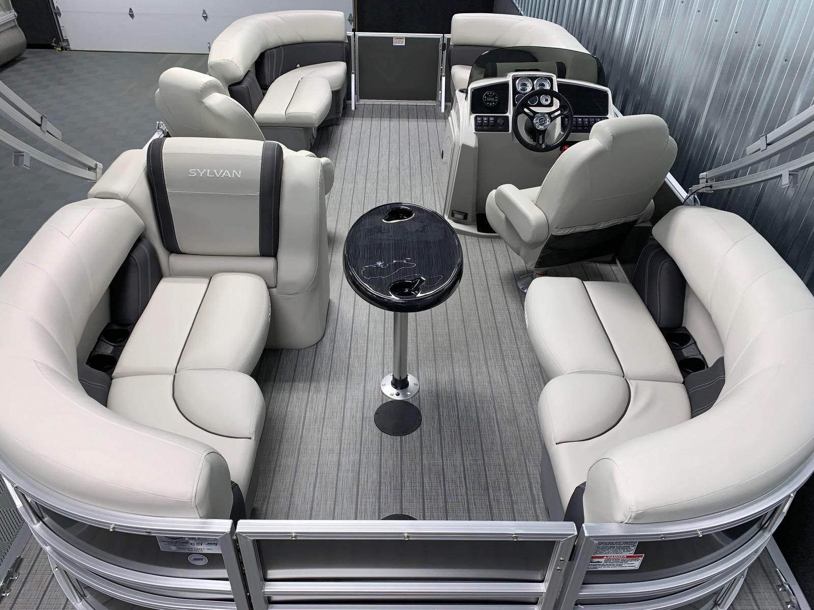 Teak Weave Vinyl Flooring of a 2021 Sylvan Mirage 8520 LZ Tritoon Boat