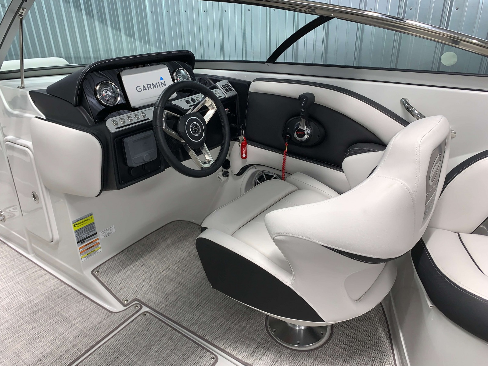 Helm with Black Accents of the 2021 Crownline 255 SS Bowrider Boat