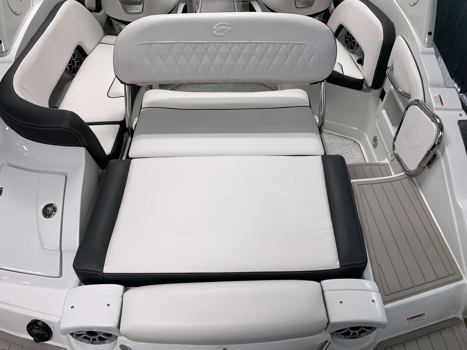 Rear Facing Swing Back Seat of the 2021 Crownline 255 SS Bowrider Boat