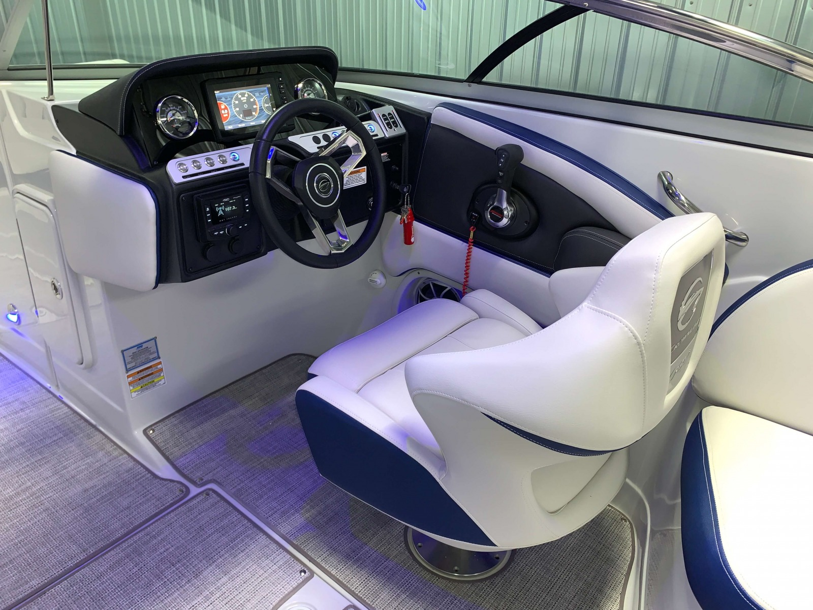 Black Accented Helm of the 2021 Crownline 265 SS Bowrider Boat