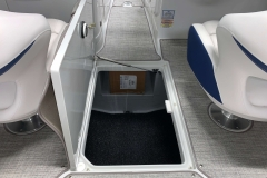 Lockable Subfloor Storage of the 2021 Crownline 265 SS Bowrider Boat
