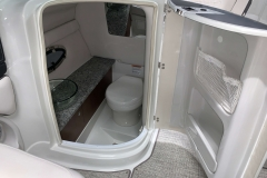 Enclosed Head with Electric Flush of the 2021 Crownline 270 XSS Bowrider Boat