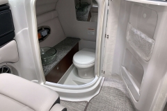 Enclosed Head with Electric Flush of the 2021 Crownline 280 SS Bowrider Boat