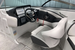 Black Accented Helm of the 2021 Crownline 280 SS Bowrider Boat