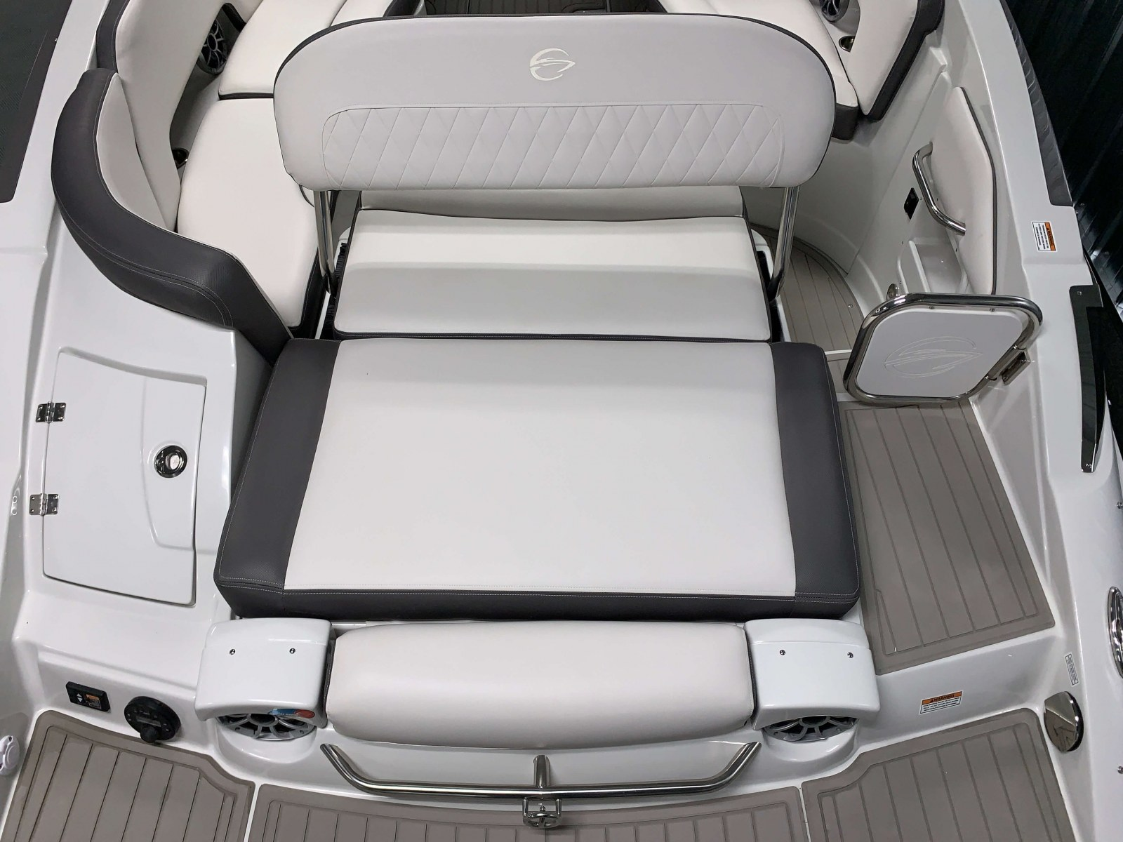Aft Electric Sun Lounge Seat of the Slate and Onyx Exterior Colors on the 2021 Crownline 290 SS Bowrider Boat