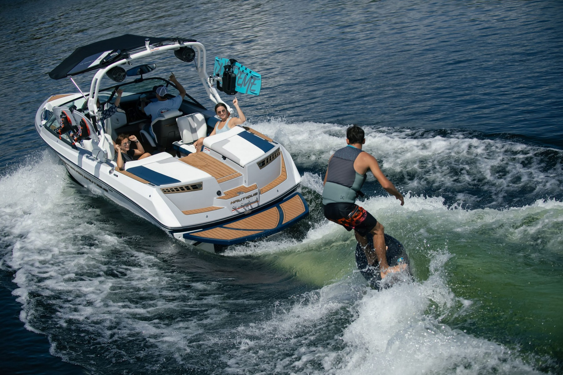 Wake Surfing Behind the 2022 Nautique 210 Wake Boat