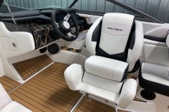 Helm Seat Bolster of the 2021 Nautique 230 Wake Boat
