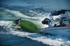 Wake Surfing Behind the 2022 Nautique G23 Wake Boat