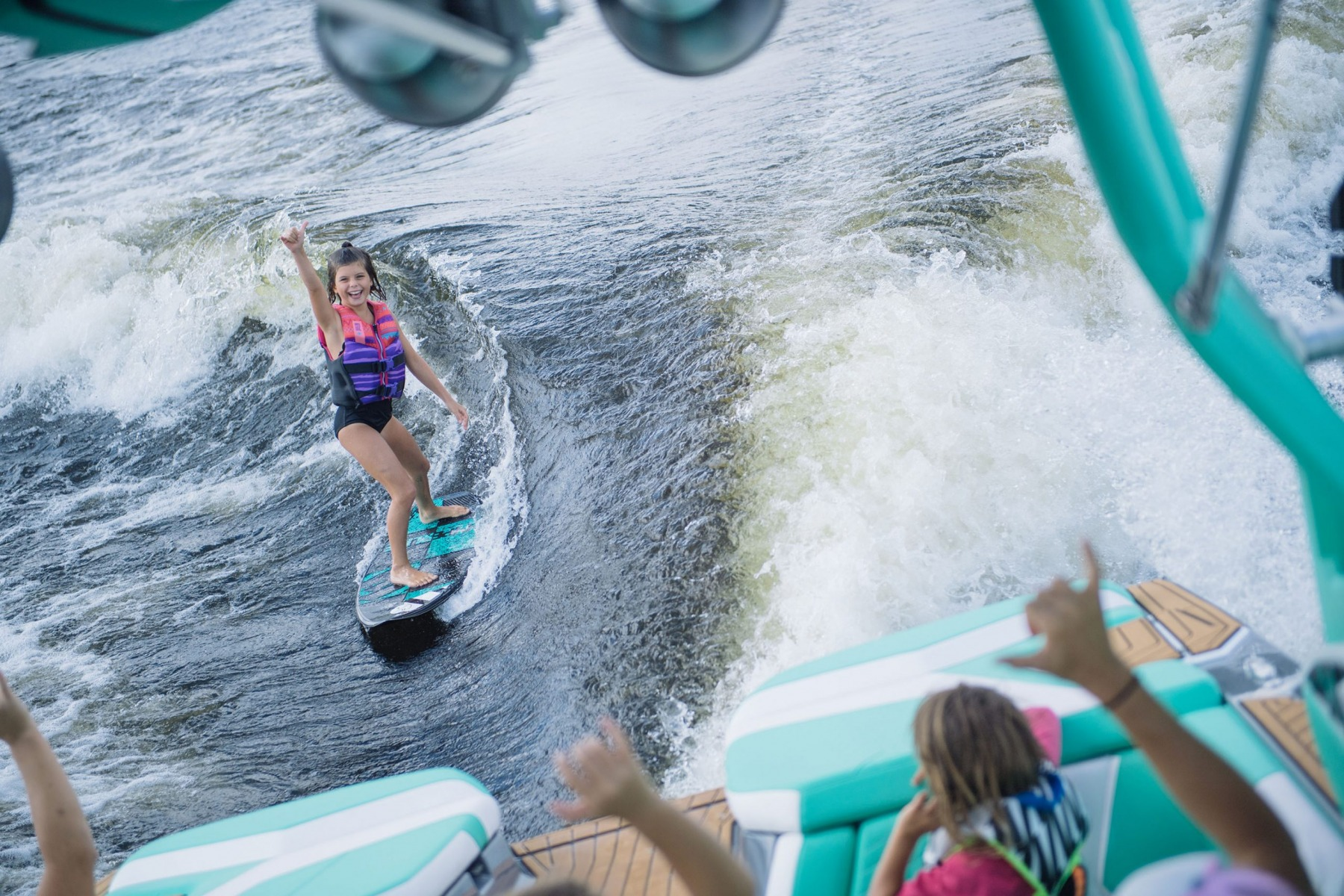 Wake Surfing Behind the 2022 Nautique G25 Wake Boat