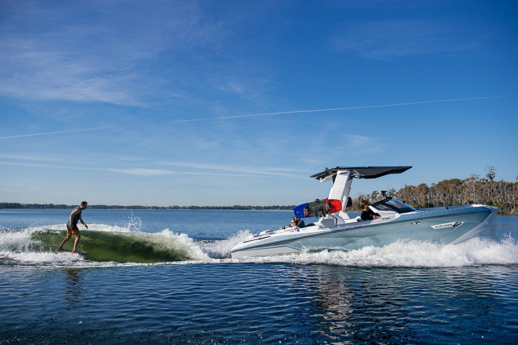 Wake Surfing Behind the 2022 Nautique G25 Paragon Wake Boat
