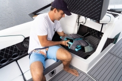 Observer Seat Storage of a 2022 Nautique GS20 Wake Boat