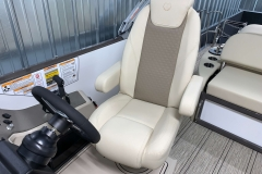 Adjustable Captain's Chair of the 2021 Premier 230 Solaris RL Tritoon Boat