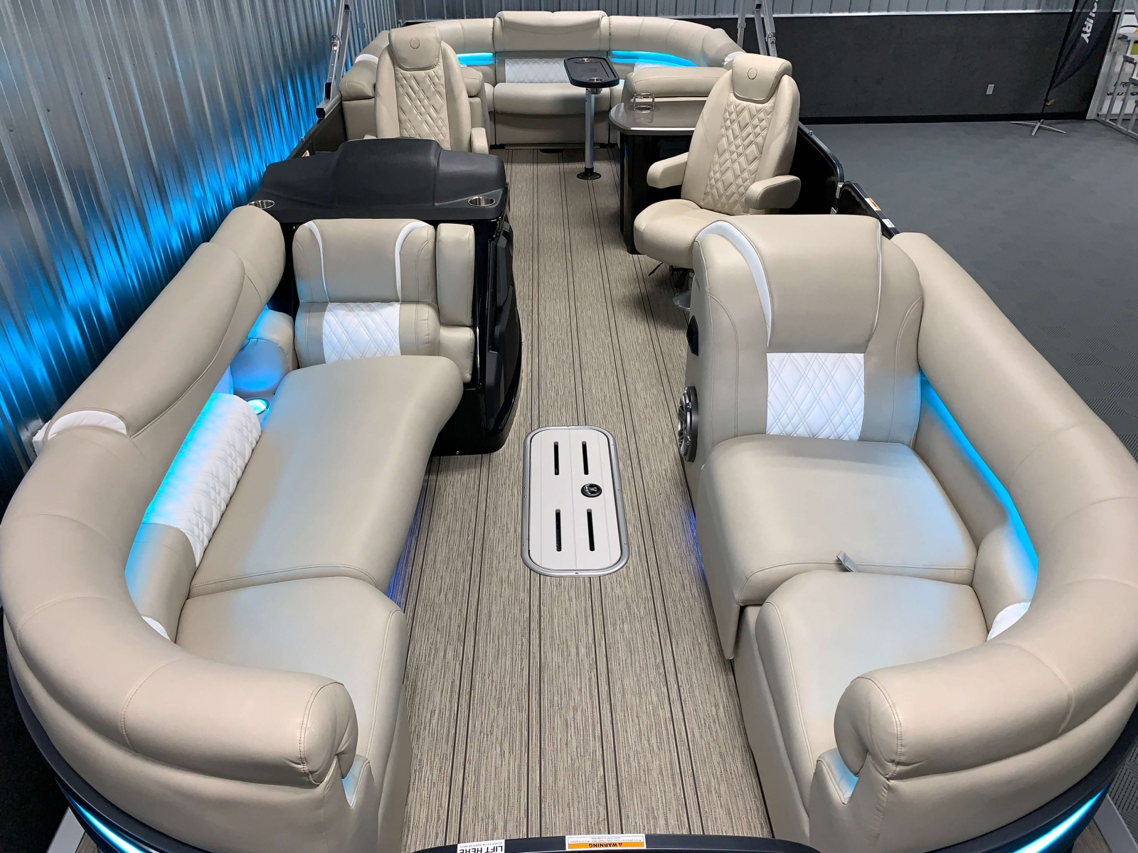 Teak Vinyl Floor on the 2021 Premier 250 Intrigue RF Tritoon Boat