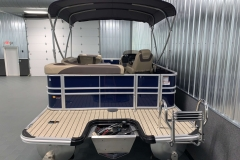 Rear Swim Deck Ladder of the 2022 Sylvan L1 Cruise Pontoon Boat