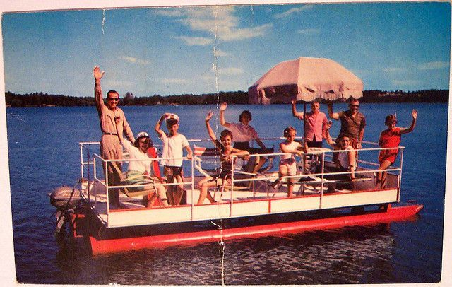 Pontoon Boats today have come a long way from this Vintage Pontoon Beauty. Looks like they're having fun though!