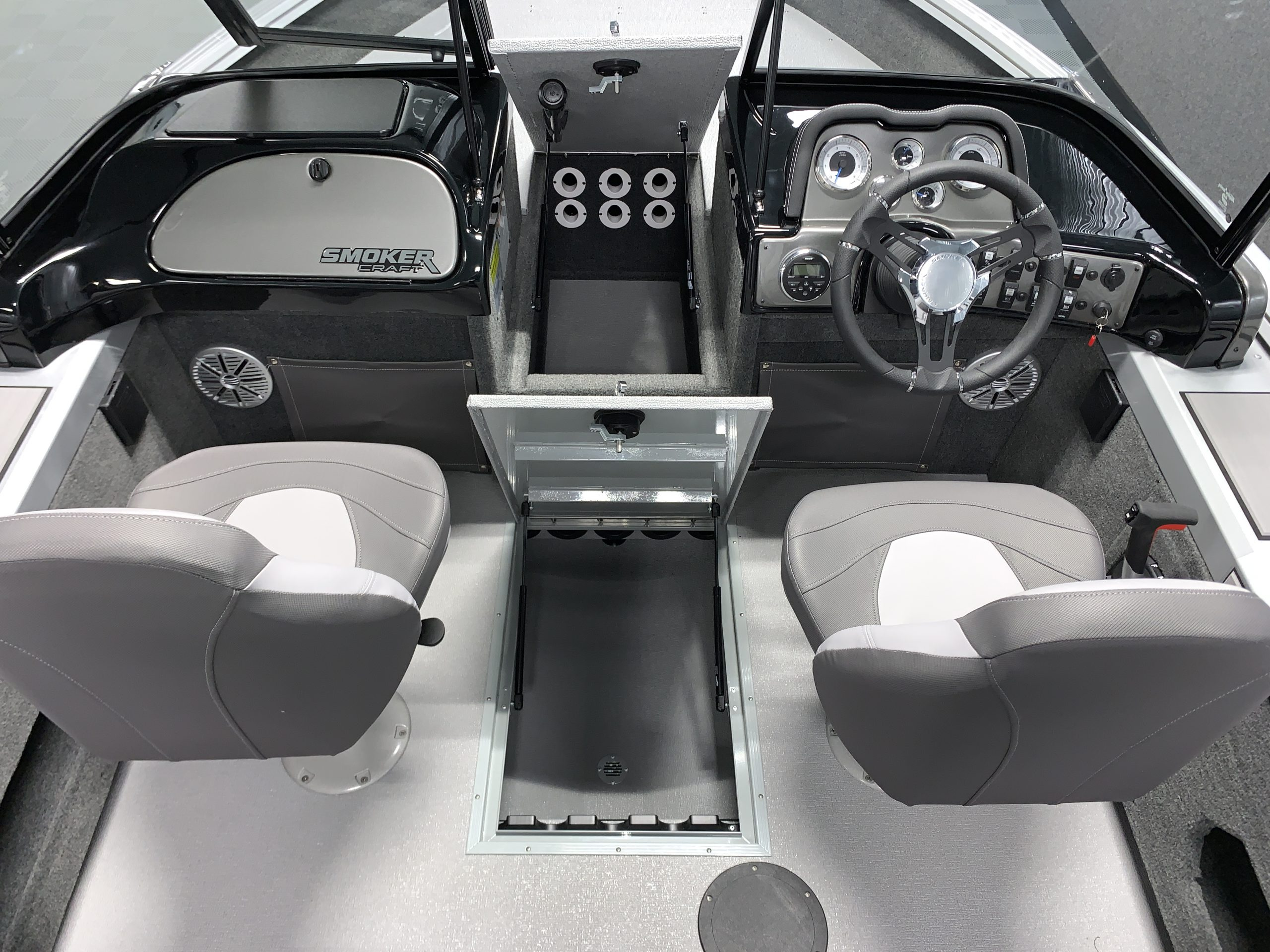 On select models, the boat features top-loading gunnel storage, bow storage, and subfloor storage compartments for fishing rods.