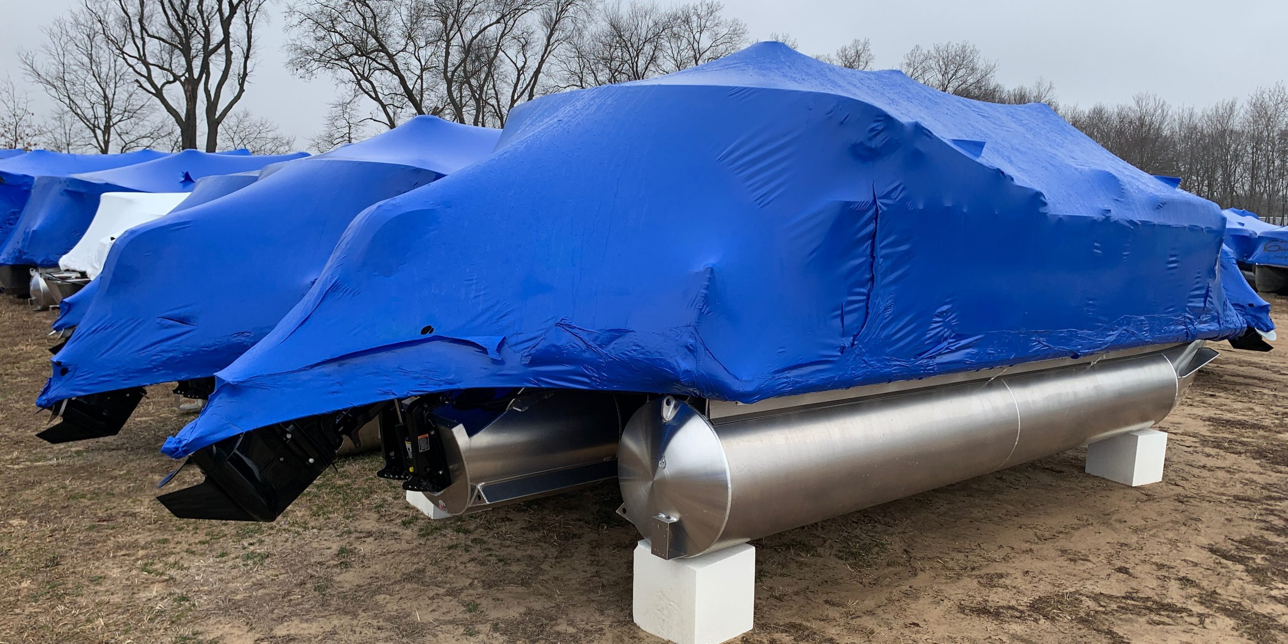 These wrapped and winterized pontoons are just begging to get back out on the water.